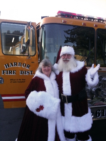 Santa and Mrs Claus with fire truck
